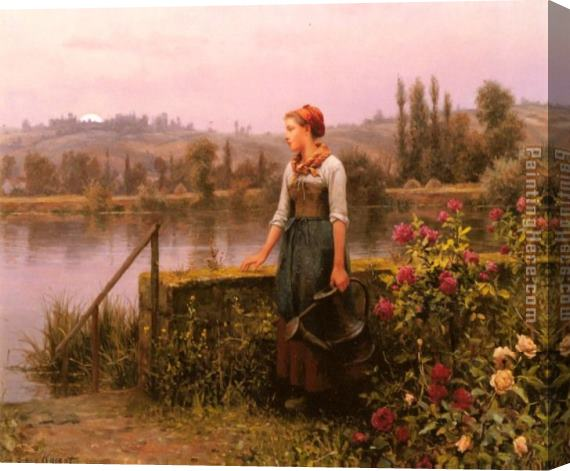 Daniel Ridgway Knight A Woman with a Watering Can by the River Stretched Canvas Painting
